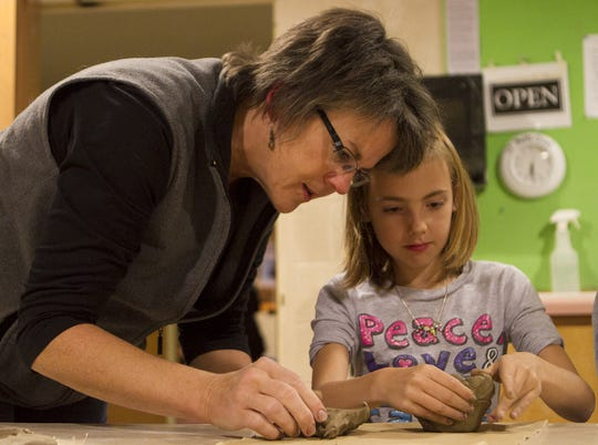 Kathleen Rulka has announced her intention of running against Rep. Bob Kulp. Kulp had been unopposed. In this picture, Rulka, left, helps Daylen Franck, 8, make a bowl in 2012 at the Chestnut Avenue Center for the Arts in Marshfield.