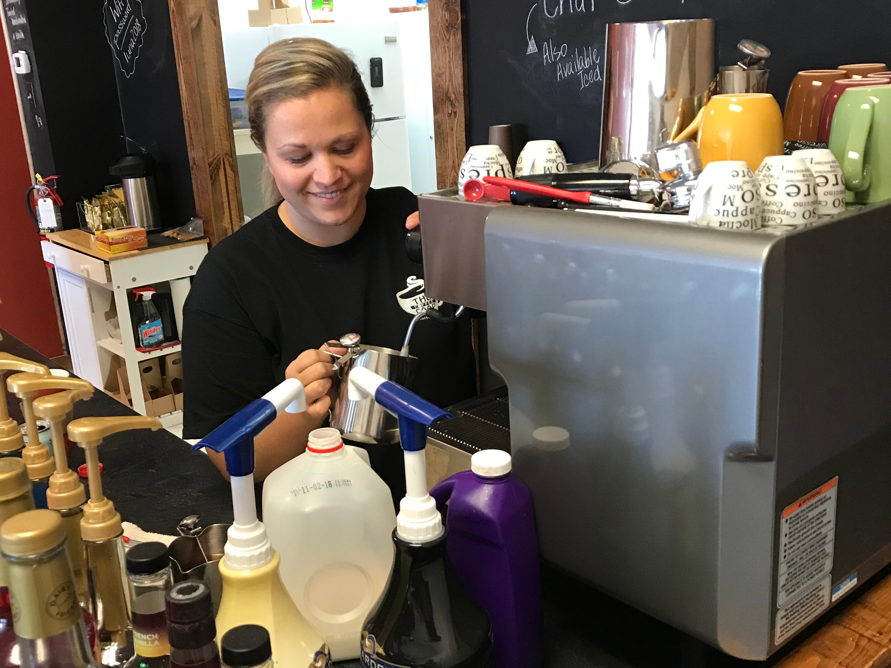 Ariel Oehmichen makes coffee with her espresso maker at The Coffee Coop in Colby.