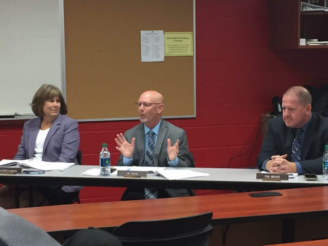 Shelby superintendent Tim Tarvin makes a point at Monday's school board meeting. He is flanked by treasurer Libby Anatra and assistant superintendent Paul Walker.