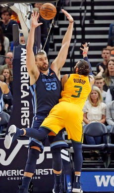 Memphis Grizzlies center Marc Gasol (33) defends as Utah Jazz guard Ricky Rubio (3) shoots in the first half of an NBA basketball game, Monday, Oct. 22, 2018, in Salt Lake City.