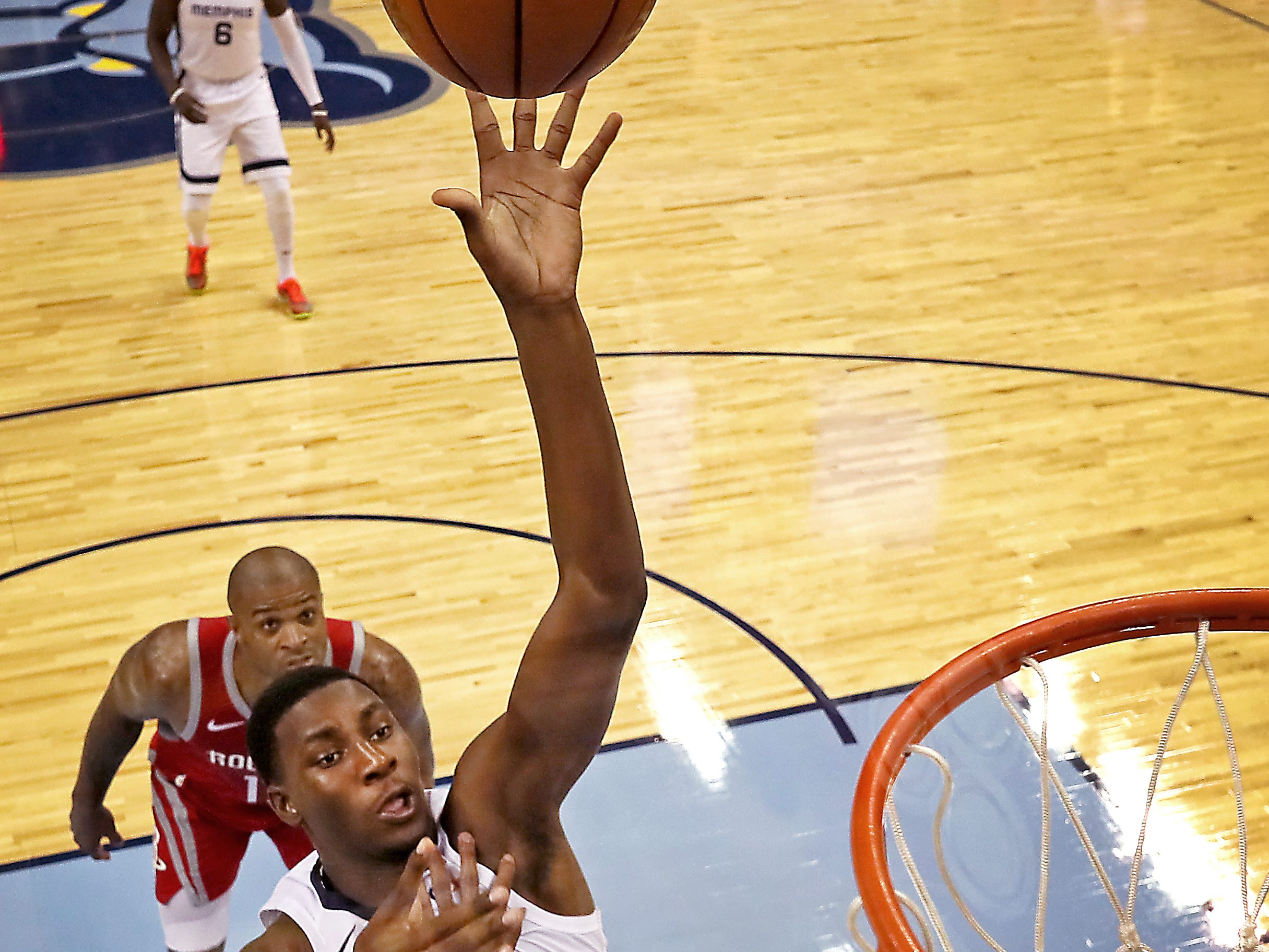 Memphis Grizzlies forward Jaren Jackson Jr. makes a shot over Houston Rockets forward Carmelo Anthony during their preseason game at the FedExForum on Friday, Oct. 12, 2018.