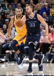 Oct 22, 2018; Salt Lake City, UT, USA; Memphis Grizzlies center Marc Gasol (33) dribbles the ball up the court with Utah Jazz center Rudy Gobert (27) looking to steal the ball during the second quarter at Vivint Smart Home Arena.