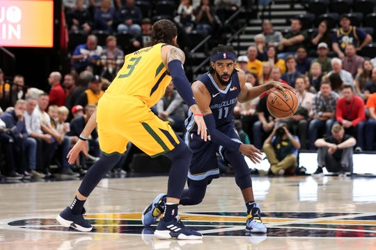 Oct 22, 2018; Salt Lake City, UT, USA; Memphis Grizzlies guard Mike Conley (11) dribbles the ball while guarded by Utah Jazz guard Ricky Rubio (3) during the first quarter at Vivint Smart Home Arena.