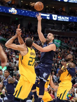 Oct 22, 2018; Salt Lake City, UT, USA; Memphis Grizzlies center Marc Gasol (33) shoots the ball over Utah Jazz center Rudy Gobert (27) during the second quarter at Vivint Smart Home Arena.