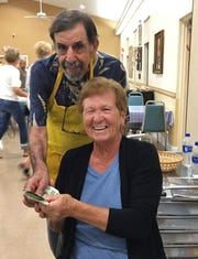 Shirley Maas, with Bingo committee member Ken Bonfield, was a big winner at JCMI's Monday Night Bingo.