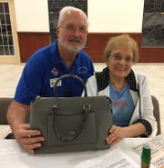 On Thursday, Oct. 18, the Knights of Columbus San Marco Council #6344 hosted a Bingo fundraiser in the San Marco Parish Center. Above, Coach bag winner, Peggy Frederick of Marco Island with Knight Frank Reifsnyder.