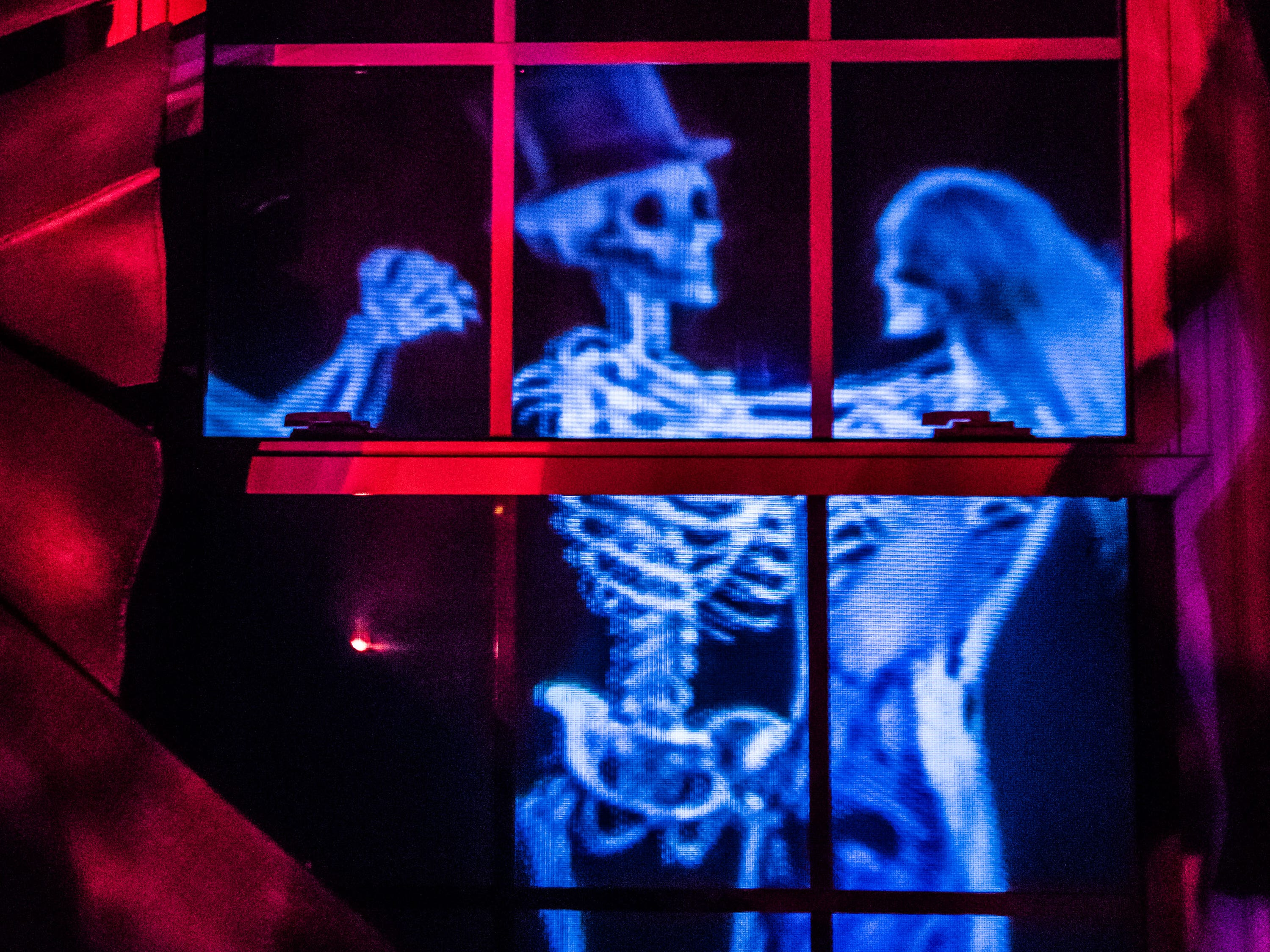 Animated skeletons are seen dancing around the inside of Bob Fuchs' haunted house at 18130 Midland Place in Brookfield on Monday, Oct. 22, 2018. The elaborate Halloween decorations draw a large crowd of trick-or-treaters each year.
