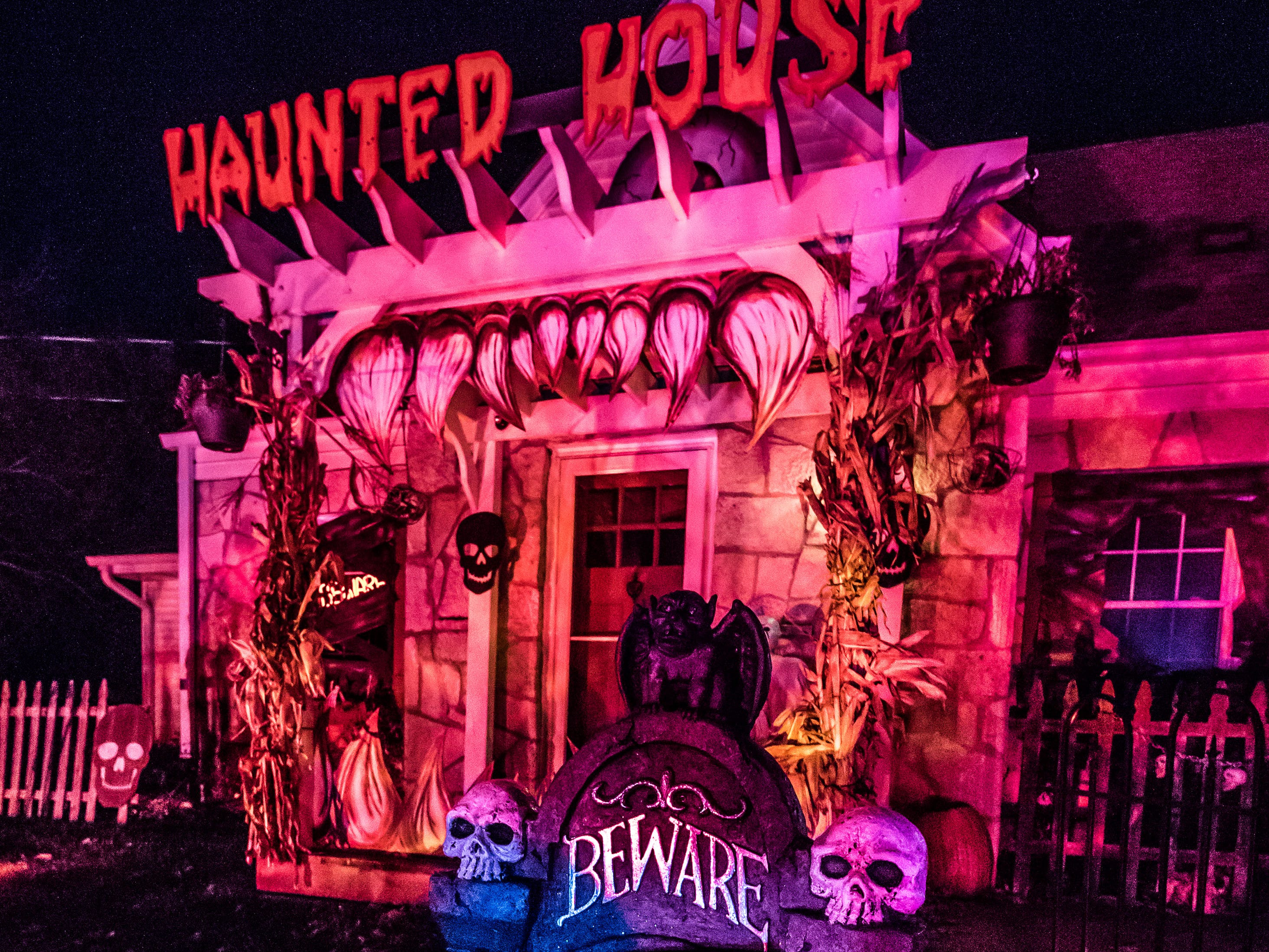 Elaborate Halloween decorations transform Bob Fuchs' Brookfield home into a forbidding haunted house as seen on Monday, Oct. 22, 2018. The display draws a large crowd of trick-or-treaters each year.