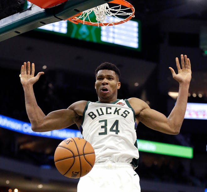 Giannis Antetokounmpo dunks during the game against the Knicks Monday night at Fiserv Forum.