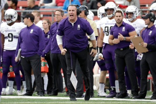 Northwestern head coach Pat Fitzgerald talks to his team during the first half of an NCAA college football game against Rutgers, Saturday, Oct. 20, 2018, in Piscataway, N.J. (AP Photo/Julio Cortez) ORG XMIT: NJJC109