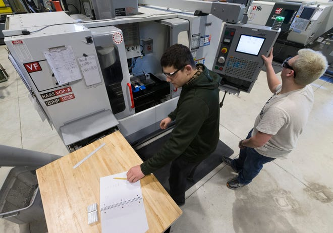 CNC machinist student Andrew Fairchild (right) assists Union Grove High School student Jared Verwey is setting up a machine during class last March at  Gateway Technical College's  SC Johnson iMET Center inSturtevant.  Gateway held a groundbreaking ceremony Tuesday for a project that will significantly expand the center.  MARK HOFFMAN/MILWAUKEE JOURNAL SENTINEL