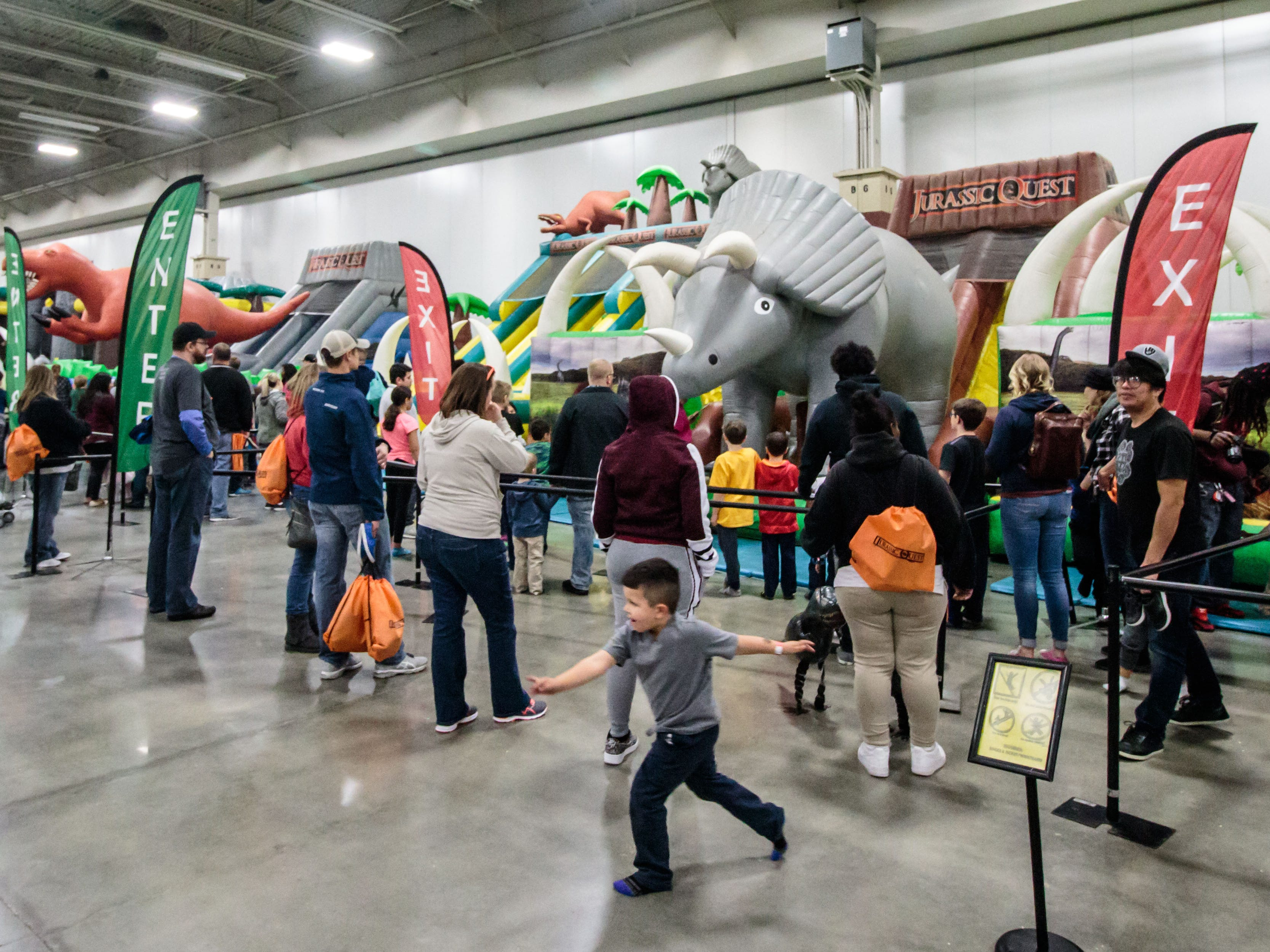 Youngsters enjoy a variety of bounce houses during Jurassic Quest at Wisconsin State Fair Park in West Allis on Sunday, Oct. 21, 2018. The three-day event featured more than 80 life-sized animatronic dinosaurs, fossils, games, crafts, bounce houses and more.