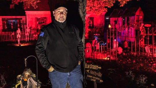 Bob Fuchs stands outside his elaborately decorated haunted house at 18130 Midland Place in Brookfield on Monday, Oct. 22, 2018. The display draws a large crowd of trick-or-treaters each year.