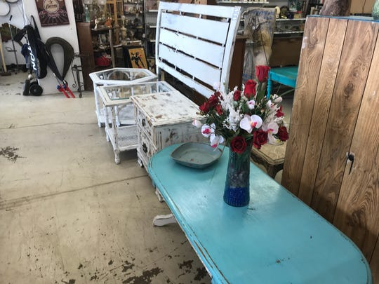RoBo Depot sells new, used and repainted furniture. The Bridges started their business by selling refurbished furniture online, and they've steadily developed a customer base.