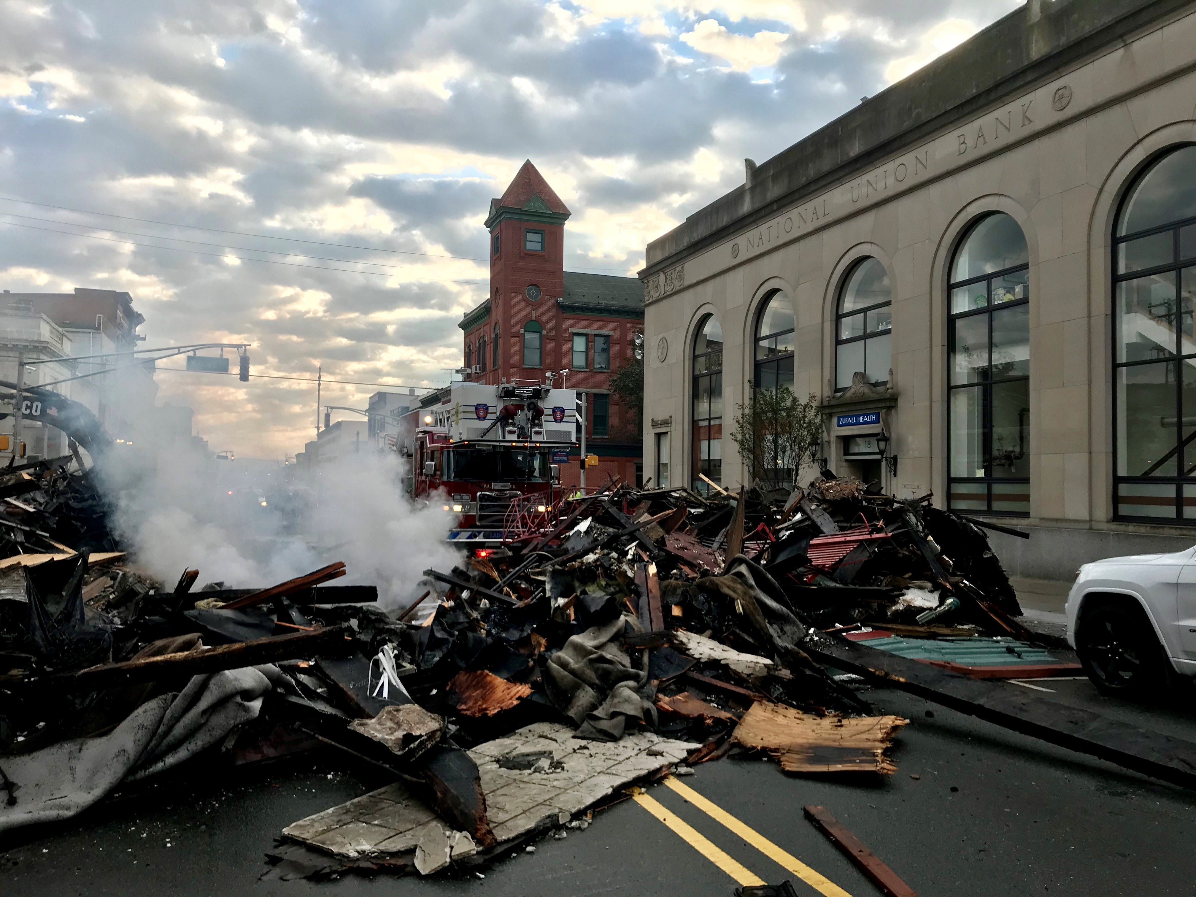 Zufall Health Center, located in the historic former National Union Bank Building in Dover, is closed on Tuesday, Oct. 23, 2018, due to a fire that collapsed a building across Blackwell Street the day before. Debris from the collapse is seen here on Blackwell Street.