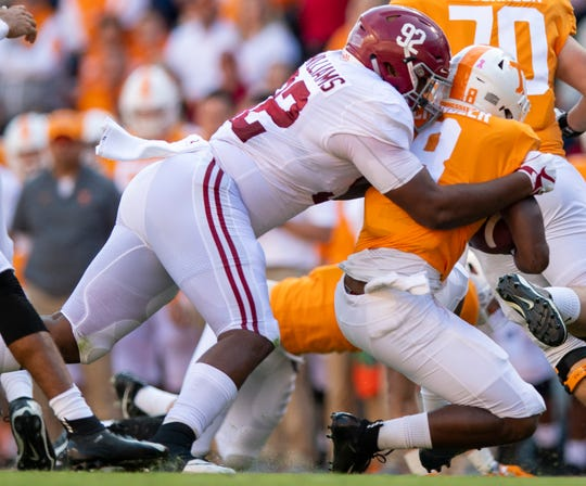 Alabama defensive lineman Quinnen Williams (92) stops Tennessee running back Ty Chandler (8) in first half action at Neyland Stadium in Knoxville, Tn., on Saturday October 20, 2018.