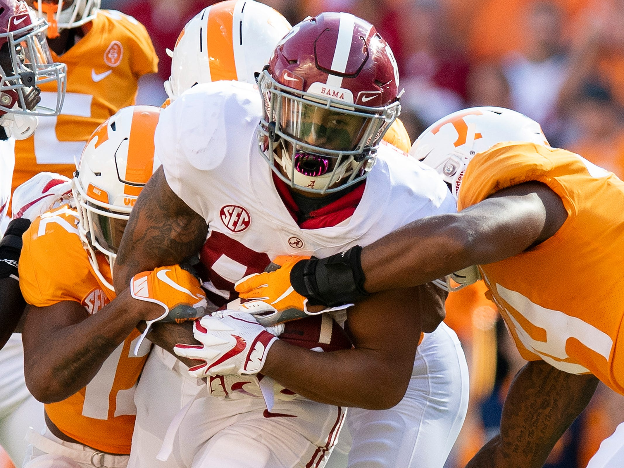 Alabama tight end Irv Smith Jr. (82) is stopped by Tennessee in first half action at Neyland Stadium in Knoxville, Tn., on Saturday October 20, 2018.