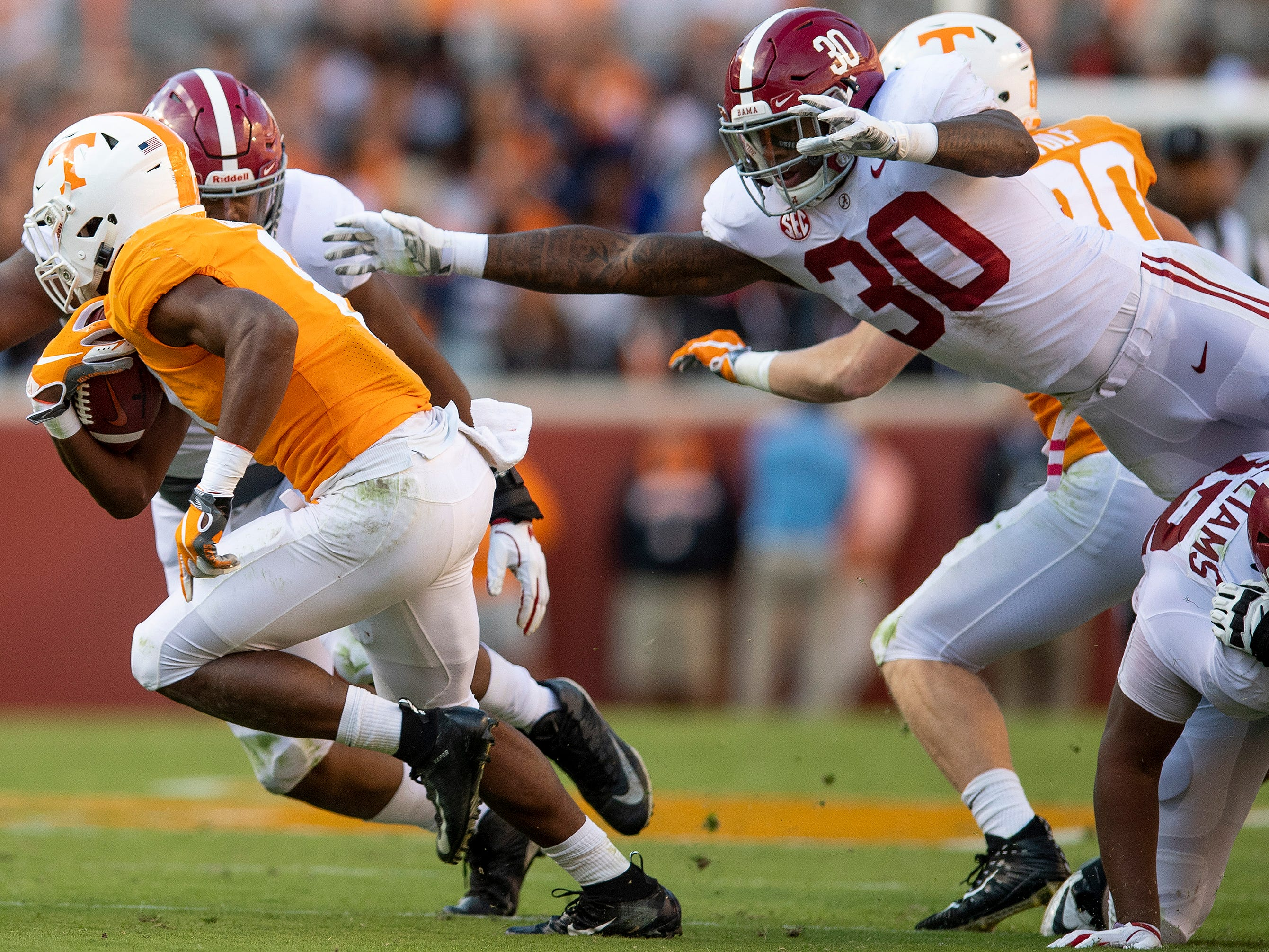 Alabama linebacker Mack Wilson (30) and defensive lineman LaBryan Ray (89) pursue Tennessee running back Ty Chandler (8) in first half action at Neyland Stadium in Knoxville, Tn., on Saturday October 20, 2018.