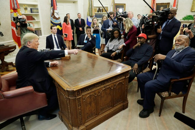 President Donald Trump talks to NFL Hall of Fame football player Jim Brown, seated right, and Rapper Kanye West, seated center, and others in the Oval Office of the White House, Thursday, Oct. 11, 2018, in Washington.   (AP Photo/Evan Vucci)