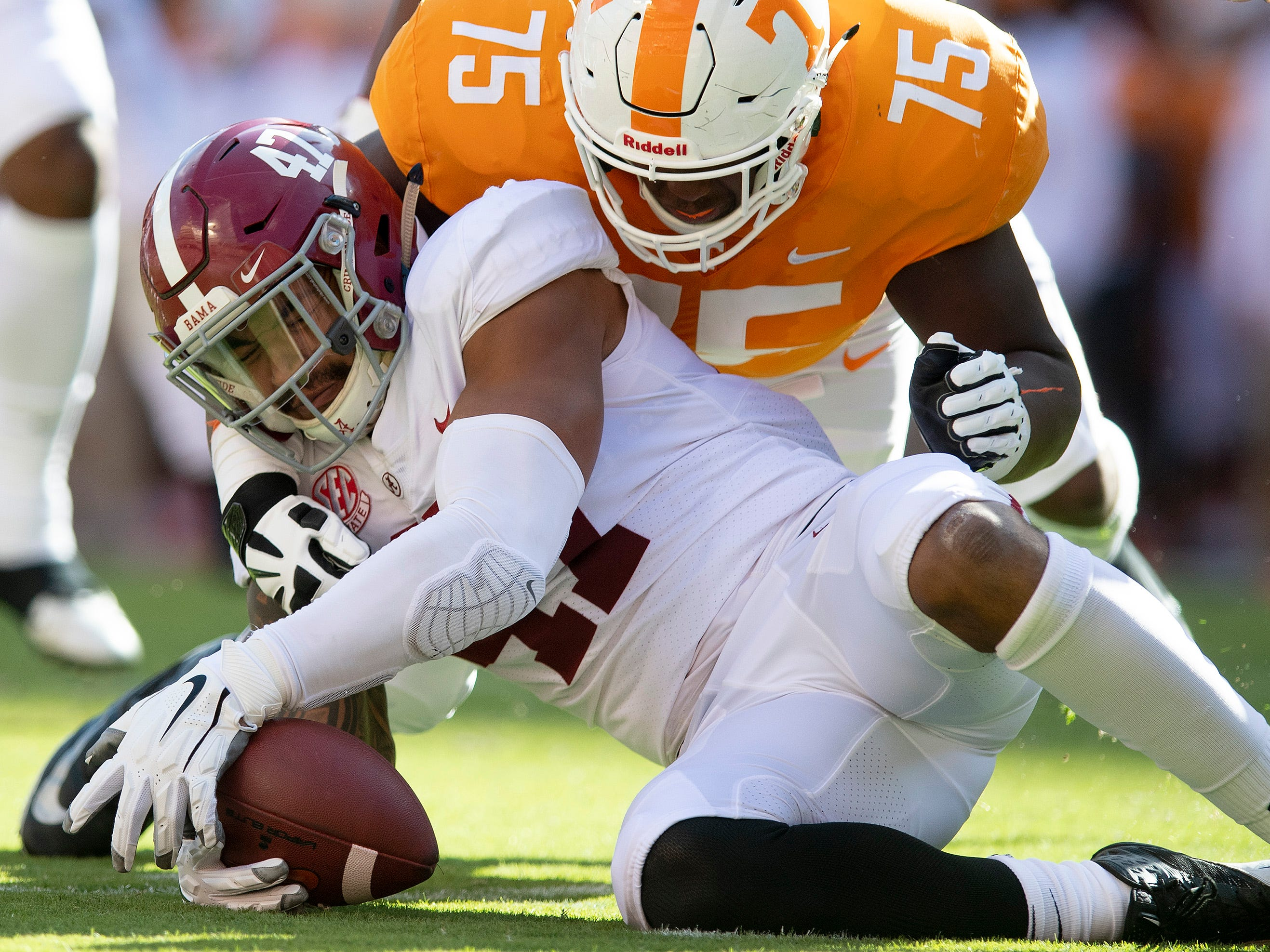 Alabama linebacker Christian Miller (47) rovers a Tennessee  fumble in first half action at Neyland Stadium in Knoxville, Tn., on Saturday October 20, 2018.