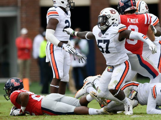 Auburn's Deshaun Davis tackles Ole Miss runner Scottie Phillips on 4th down on Saturday, Oct. 20, 2018 in Oxford, MS.