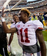 Alabama wide receivers Henry Ruggs, III, (11) and  Chadarius Townsend (12) chat as they walk off of the field after defeating Tennessee at Neyland Stadium in Knoxville, Tn., on Saturday October 20, 2018.