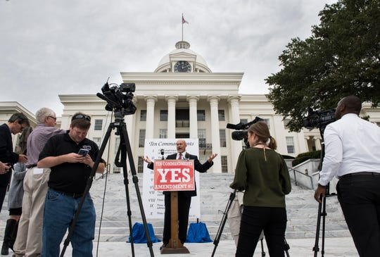 Dean Young, supporter of the Ten Commandments amendment, speaks to reporters on the steps of the Alabama State Capitol building in Montgomery, Ala., on Tuesday, Oct. 23, 2018.