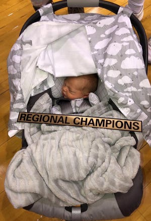 New Castle volleyball coach Sarah Roush gave birth to her first son, Ridge, the day after winning sectional. Roush said he slept through the Trojans' regional title win.