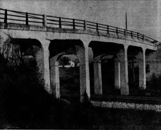 The Whitney Road Viaduct - shown here in a photo from 1969 - carried motorists over a line of the New York Central Railroad (CSX today).