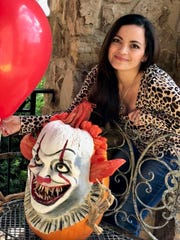 "Liza Slaughter Barker carved and painted a pumpkin to look like Pennywise from the movie ""It."""