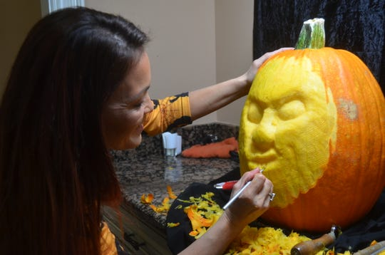 Liza Slaughter-Barker carves a pumpkin 3D-style in her Hendersonville home.