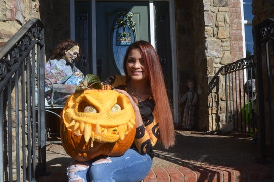 Liza Slaughter-Barker sculpts 3D-style pumpkins and other characters, including zombies, at her Hendersonville home.