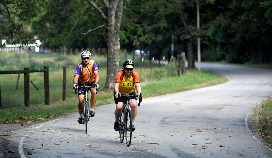 Vic and Lisa Hardin bike down a scenic road in Fernvale on Oct. 9, 2018. Brentwood is examining the possibility of adding bike lanes to Granny White Pike as part of a repaving project.