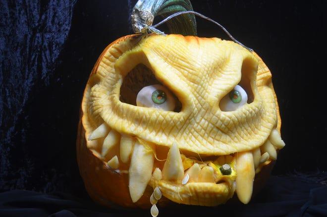 Liza Slaughter-Barker of Hendersonville creates 3D-style pumpkin carvings each Halloween season.