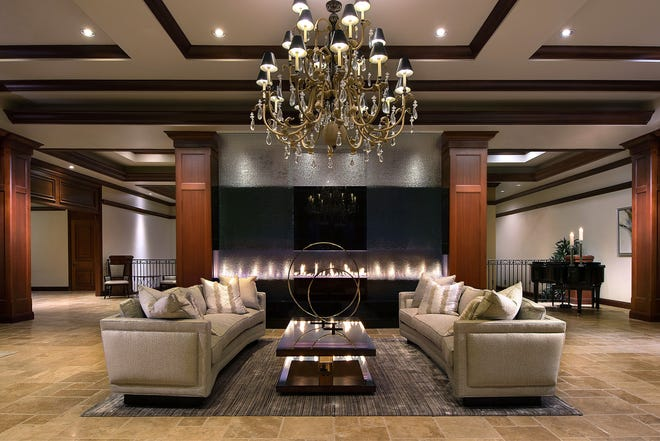 A dramatic fire feature welcomes residents and guests in Quail West's newly renovated and expanded clubhouse.