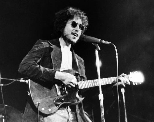 "In this Jan. 1, 1972, file photo, Bob Dylan performs at the Academy of Music in New York. Nashville's rock period is the subject of the next exhibit at the Country Music Hall of Fame and Museum, called ""Dylan, Cash, and the Nashville Cats: A New Music City,"" which opens in March 2015."