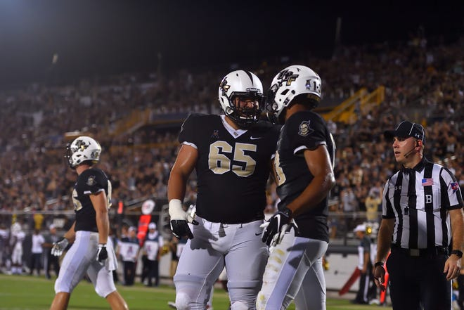 Riverdale's Cole Schneider (65) has worked his way from scout teamer to first string right guard for No. 9 UCF, which holds the nation's longest winning streak at 20 games.