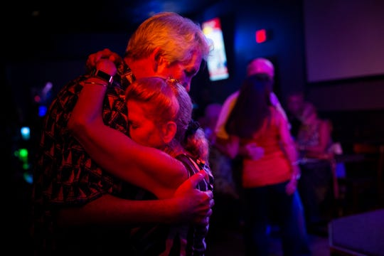 Mike and Eileen Beard dance during a performance by the Dazzling DelRays on Friday, October 12, 2018, at Dogtooth Sports and Music Bar in Naples.