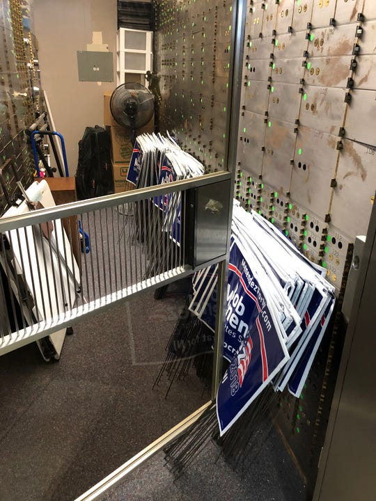 Lawn signs for U.S. Sen. Bob Menendez stashed away in a storage vault at Democratic House candidate Andy Kim's campaign headquarters on Oct. 20, 2018.