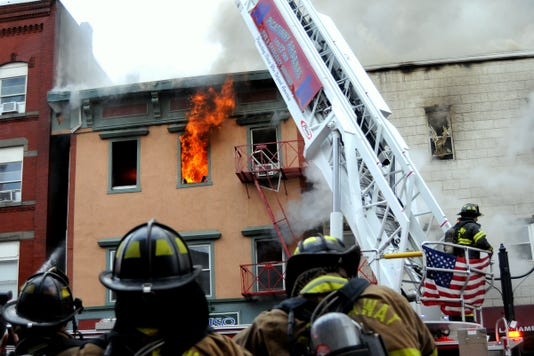 Firefighters respond to a seven-alarm fire in Dover