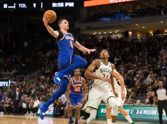 New York Knicks forward Mario Hezonja (8) shoots during the fourth quarter against the Milwaukee Bucks.