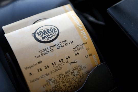 People purchase tickets for Tuesday's Mega Millions record lottery jackpot of $1.6 billion at the Lukoil on Rt. 23 South in Riverdale on Tuesday, October 23, 2018. The gas station  sold the winning lottery ticket for the $521 million jackpot drawn on March 30, 2018.