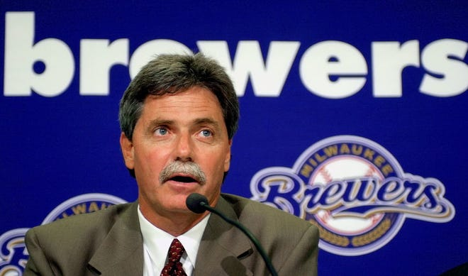Milwaukee Brewers new general manager Doug Melvin answers a question at a news conference Wednesday, Sept. 25, 2002, in Milwaukee. Melvin, a former general manager with the Texas Rangers, will replace Dean Taylor as general manager.