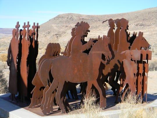 Armando Alvarez's sculpture shows multiple images of Conquistadors and priests.