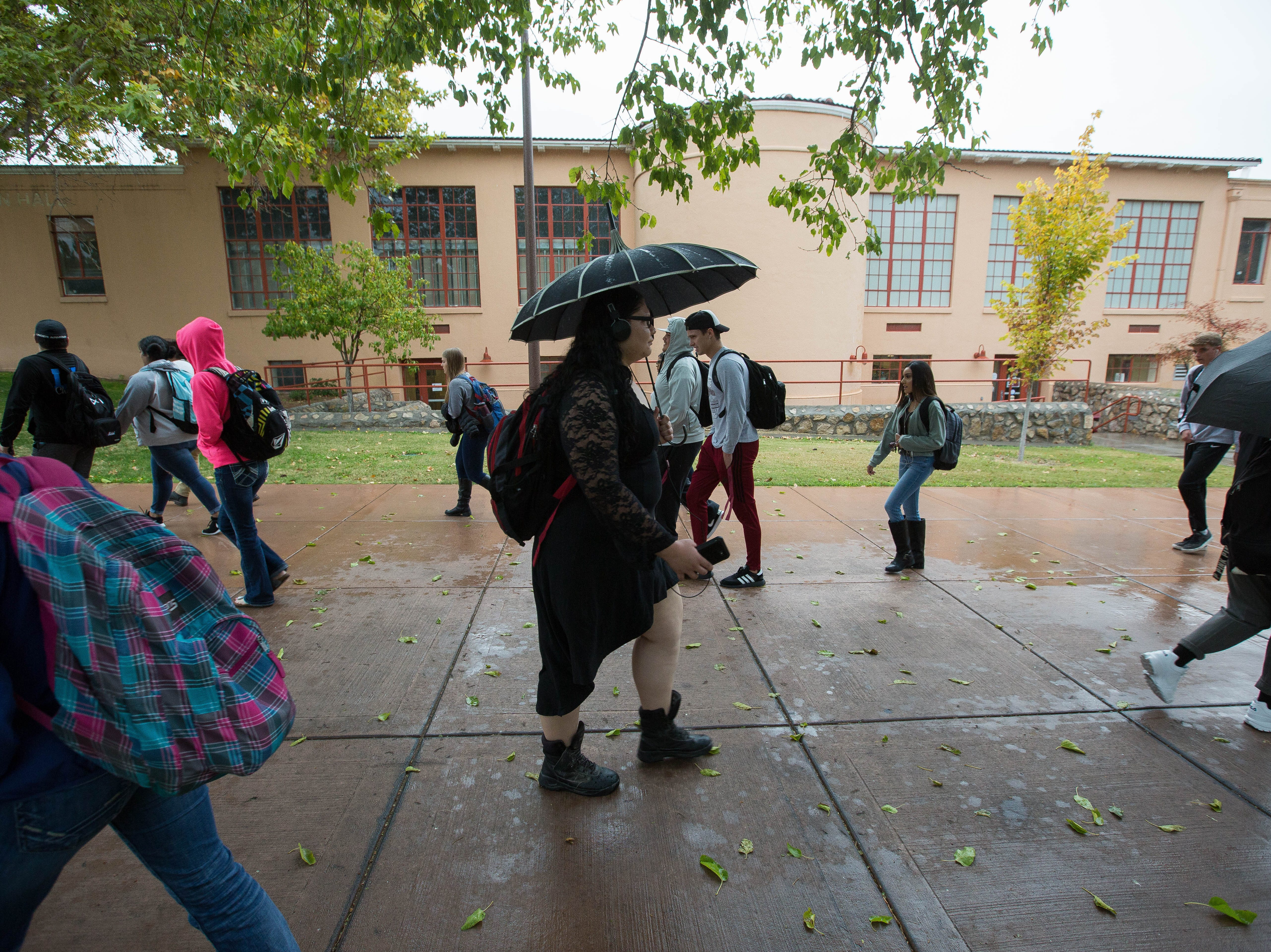 New Mexico State University students  walking through the rain between classes, Tuesday October 23, 2018.
