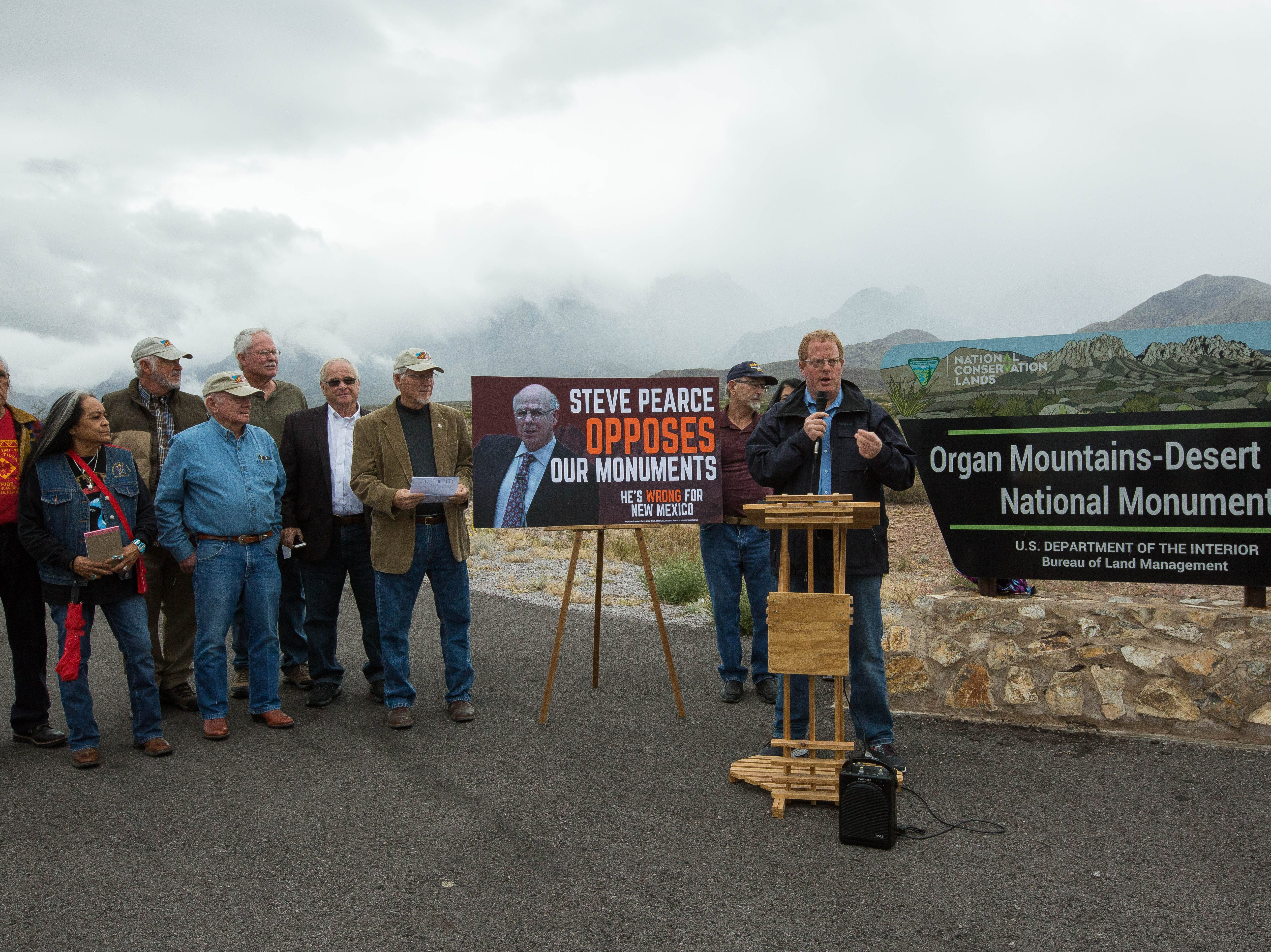 Jeff Steinborn, State Senator, addressing concerns about Steve Pearce who is running for Governor and endorsing Michelle Lujan-Grisham for Governor, as he and concerned local leaders gathered at the Organ Mountains-Desert Peaks National Monument sign.