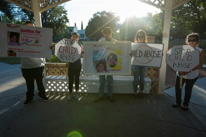 Perlis Linarez, center right, along with her family hold signs at Pioneer Women Park, where they hoped to raise awareness of child abuse and get more attention on Fabiola Rodriguez, who died under suspected child abuse, Monday October 22, 2018.