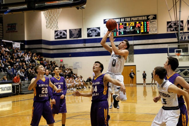 Piedra Vista's Jarrett Graham (0) scores against Kirtland Central during a nondistrict game on Jan. 11 at Jerry A. Conner Fieldhouse in Farmington. The Panthers open the new season on Dec. 1 at home against Valencia.