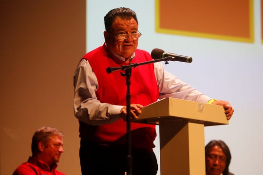 Brian Lee, field representative for U.S. Rep. Ben Ray Luján, reads a statement on Tuesday from the congressman about the National Day of Remembrance at the Phil L. Thomas Performing Arts Center in Shiprock.