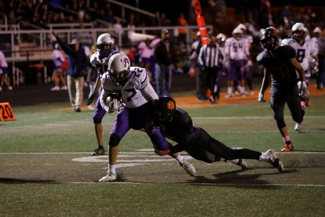 Kirtland Central's Jacob Rogers (22) fights for extra yardage after making a catch against Aztec during Friday's District 1-4A game at Fred Cook Stadium in Aztec. The Broncos moved up to No. 5 in the latest 4A rankings.